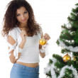 Cute young woman decorate christmas tree — Stock Photo