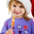 Girl in the santa claus hat — Stock Photo