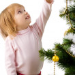 Little girl near the christmas tree and — Stockfoto