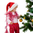 Little girl near the christmas tree and — Stok fotoğraf