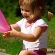 Little girl with a pink balloon — Stock Photo