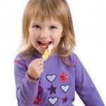 mooi klein meisje met een lichte lollipo — Stockfoto #1128428