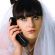 Sad bride speaks on the phone — Stock Photo