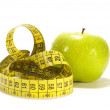 Yellow apple and tape measure — Stock Photo