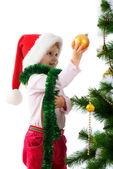Cute girl near the christmas tree — Stock Photo
