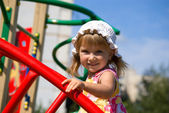 Cute little girl on playground — Stok fotoğraf