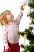 Little girl near the christmas tree and — Stock Photo