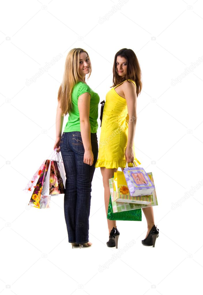 Two pretty women and bags on white background — Stock Photo #1128663
