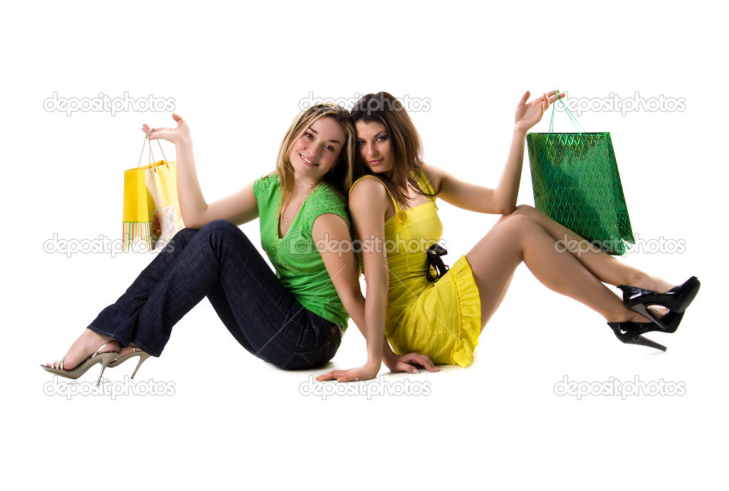 Two pretty women and bags on white background  Stock Photo #1128667
