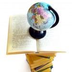 Books and world globe on white — Stock Photo