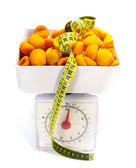 Apricots on the scale — Stock Photo