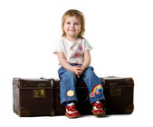 Baby sitting in a old suitcase — Stock Photo