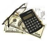 Calculator and dollars — Stock Photo