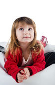 Cute little girl in a red lie — Stock Photo
