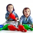 Twin brothers with skittles — Stock Photo #2534096