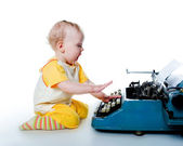 Little boy with the old typewriter — Stock Photo