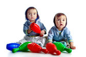Twin brothers with skittles — Stock Photo