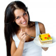 Attractive woman eating cake — Stock Photo