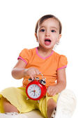 Cute little girl with the clock — Stock Photo
