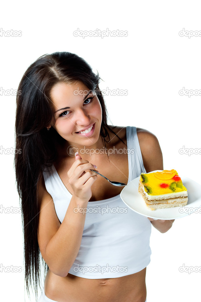 Attractive woman eating a cake. Isolated on white — Stock Photo #2585783