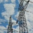 High voltage powerline over blue sky — Stock Photo #1138494
