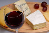 Glass of wine and cheese — Stock Photo