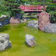Japanese red bridge in zen garden — Stock Photo