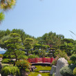 Japanese red bridge in zen garden - Stock Photo