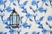Lamp on vintage wallpaper — Stock Photo