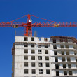 Crane on construction site — Stockfoto