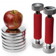 Barbells and apple isolated on white — Stock Photo