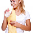 Woman holding a bottle of water — Stock Photo
