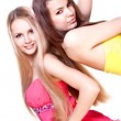 Two beautiful women in a colored dress — Stock Photo
