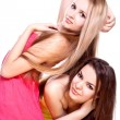Two beautiful women in a colored dress — Stock Photo #1150507