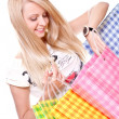 Beautiful young woman shopping — Stock Photo
