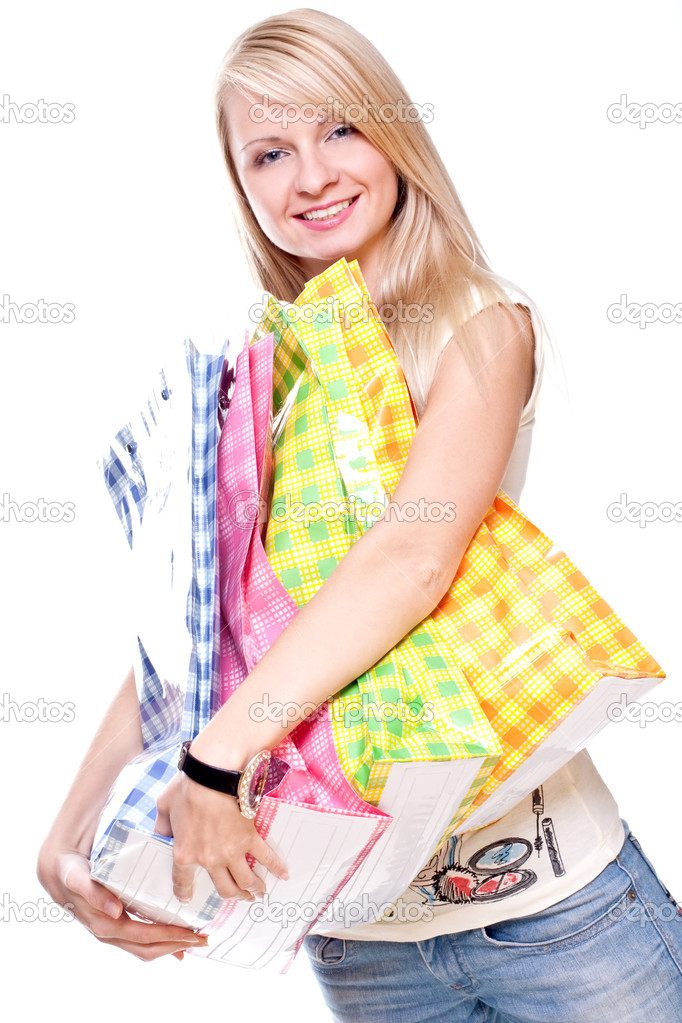 Beautiful young woman shopping on a white background — Stock Photo #1154718