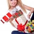 Beautiful woman with holiday gift — Stock Photo