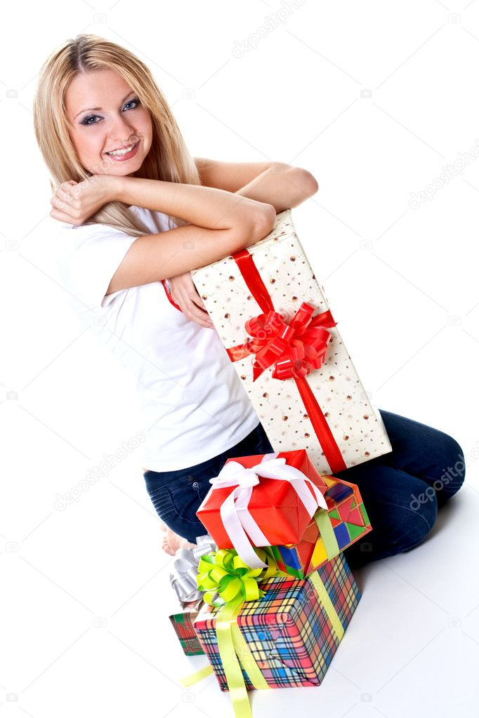 Beautiful woman with holiday gift on a white background  Stock Photo #1203979