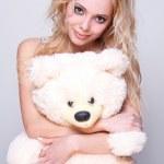 Beautiful girl with a teddy bear — Stock Photo