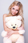 Beautiful girl with a teddy bear — Stock Photo