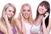 Three girls with phone — Stock Photo