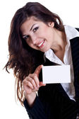 Young business woman with business card — Stock Photo