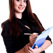 Business woman in a suit with clipboard — Stock Photo #2619130