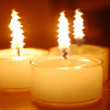 Three candles — Stock fotografie