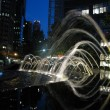 Fountain streams in night lights - Stock Photo