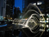 Fountain streams in night lights — Stock Photo