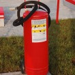 Big red fire extinguisher — Stock Photo