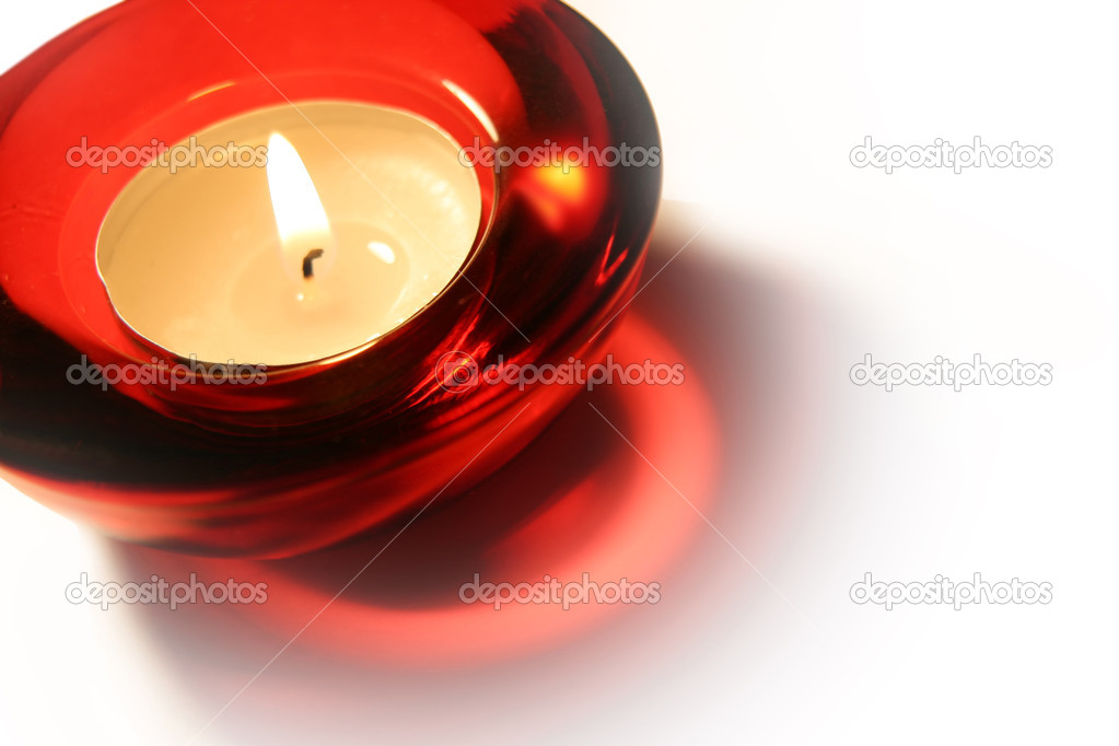 Burning candle on a white background — Stock Photo #1137590