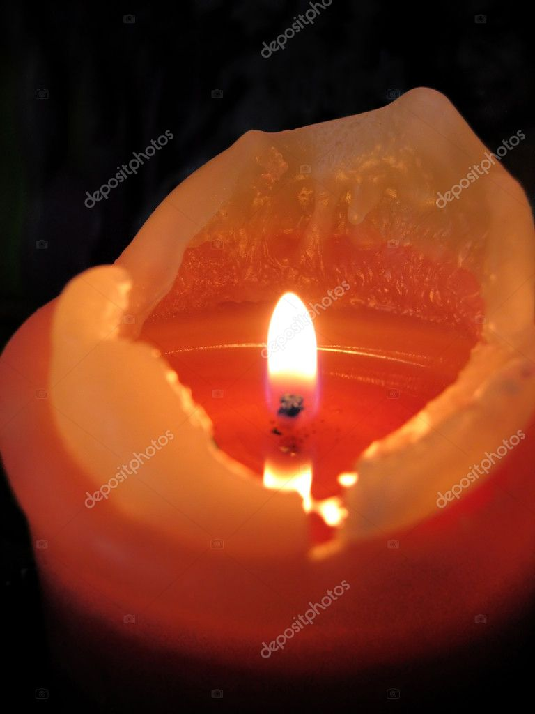 Orange burning candle on a black background — Stock Photo #1137787