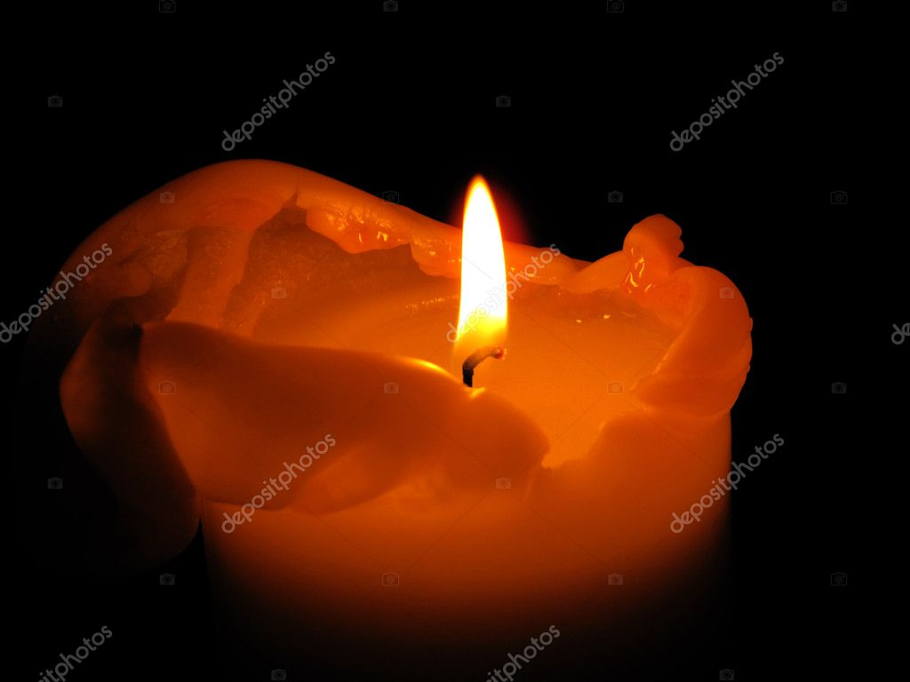Orange burning candle on a black background — Stock Photo #1173889